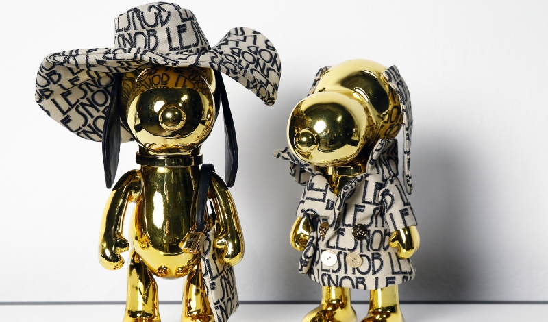 PARIS, FRANCE - SEPTEMBER 29:  Snoopy and Belle dressed by Le Snob are displayed during the 'Snoopy and Belle in fashion' exhibition at Palais de Tokyo on September 29, 2015 in Paris, France. This international exhibition of fashion, shows Snoopy and Belle dressed by thirty couturiers.  (Photo by Chesnot/Getty Images)