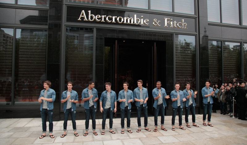 SHANGHAI, CHINA - APRIL 19:  Male models cheer at the Abercrombie & Fitch Shanghai Flagship Store Opening on April 19, 2014 in Shanghai, China.  (Photo by Kevin Lee/Getty Images)