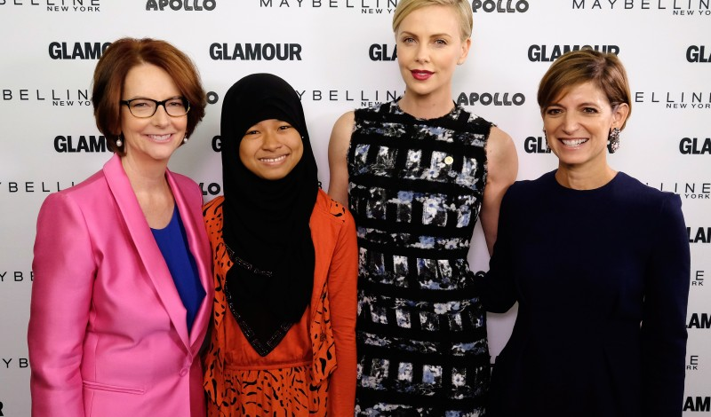 "NEW YORK, NY - SEPTEMBER 29:  (L-R) Former Australian Prime Minister Julia Gillard, Girl ambassador from Plan International Nurfahada, Founder of Charlize Theron Africa Outreach Project and U.N. Messenger of Peace Charlize Theron and Glamour's Editor-in-Chief Cindi Leive join Glamour ""The Power Of An Educated Girl"" panel at The Apollo Theater on September 29, 2015 in New York City.  (Photo by Dimitrios Kambouris/Getty Images for Glamour)"