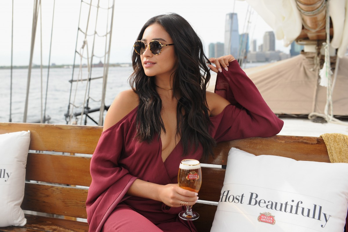 "Shay Mitchell Raises A Chalice To Toast ""Bon Voyage To Summer"" With Stella Artois"
