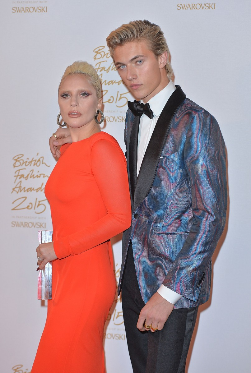 LONDON, ENGLAND - NOVEMBER 23: Lady Gaga and Lucky Blue Smith pose in the Winners Room at the British Fashion Awards 2015 at London Coliseum on November 23, 2015 in London, England. (Photo by Anthony Harvey/Getty Images)