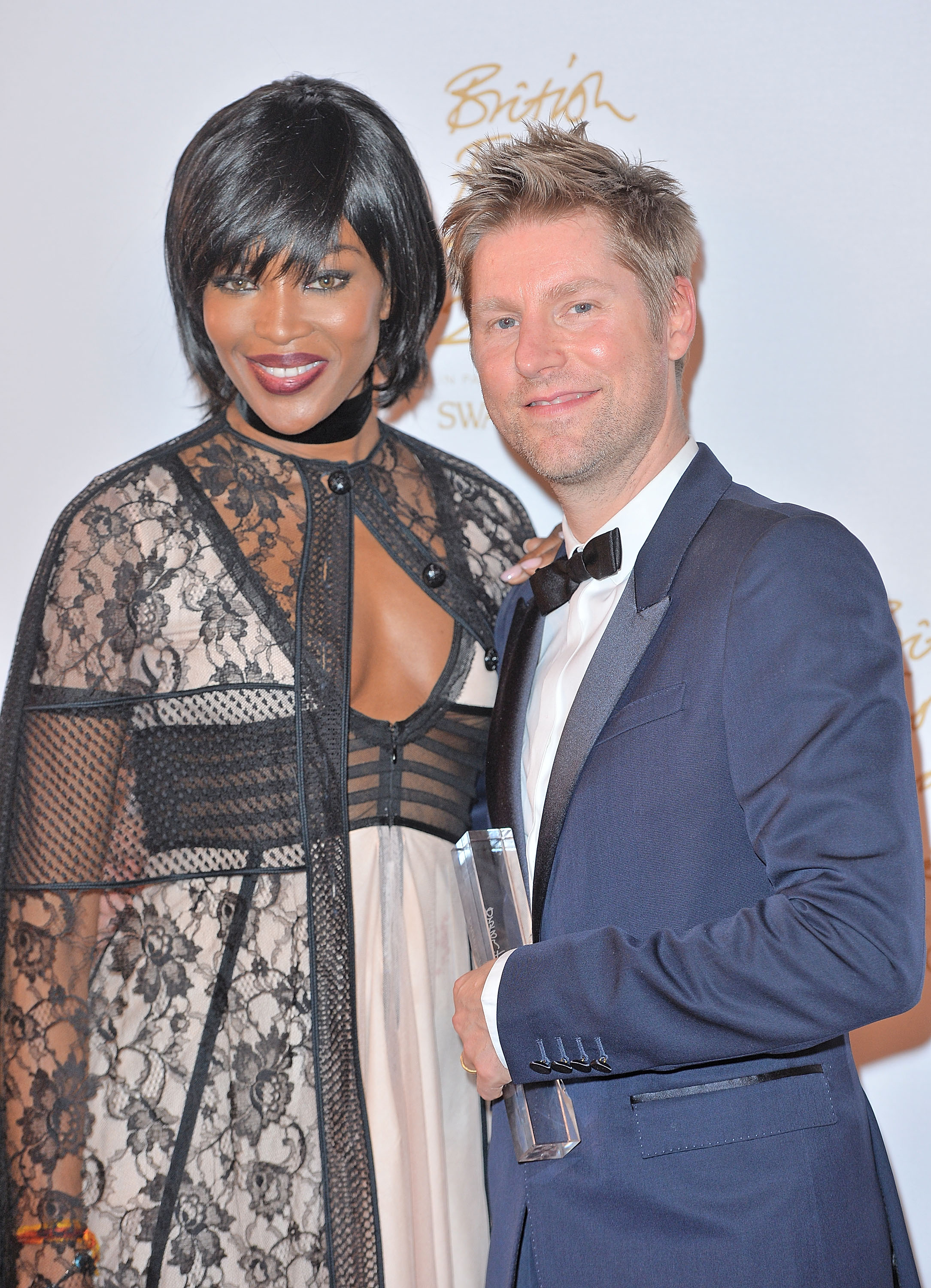 LONDON, ENGLAND - NOVEMBER 23: Naomi Campbell and Christopher Bailey pose in the Winners Room at the British Fashion Awards 2015 at London Coliseum on November 23, 2015 in London, England. (Photo by Anthony Harvey/Getty Images)