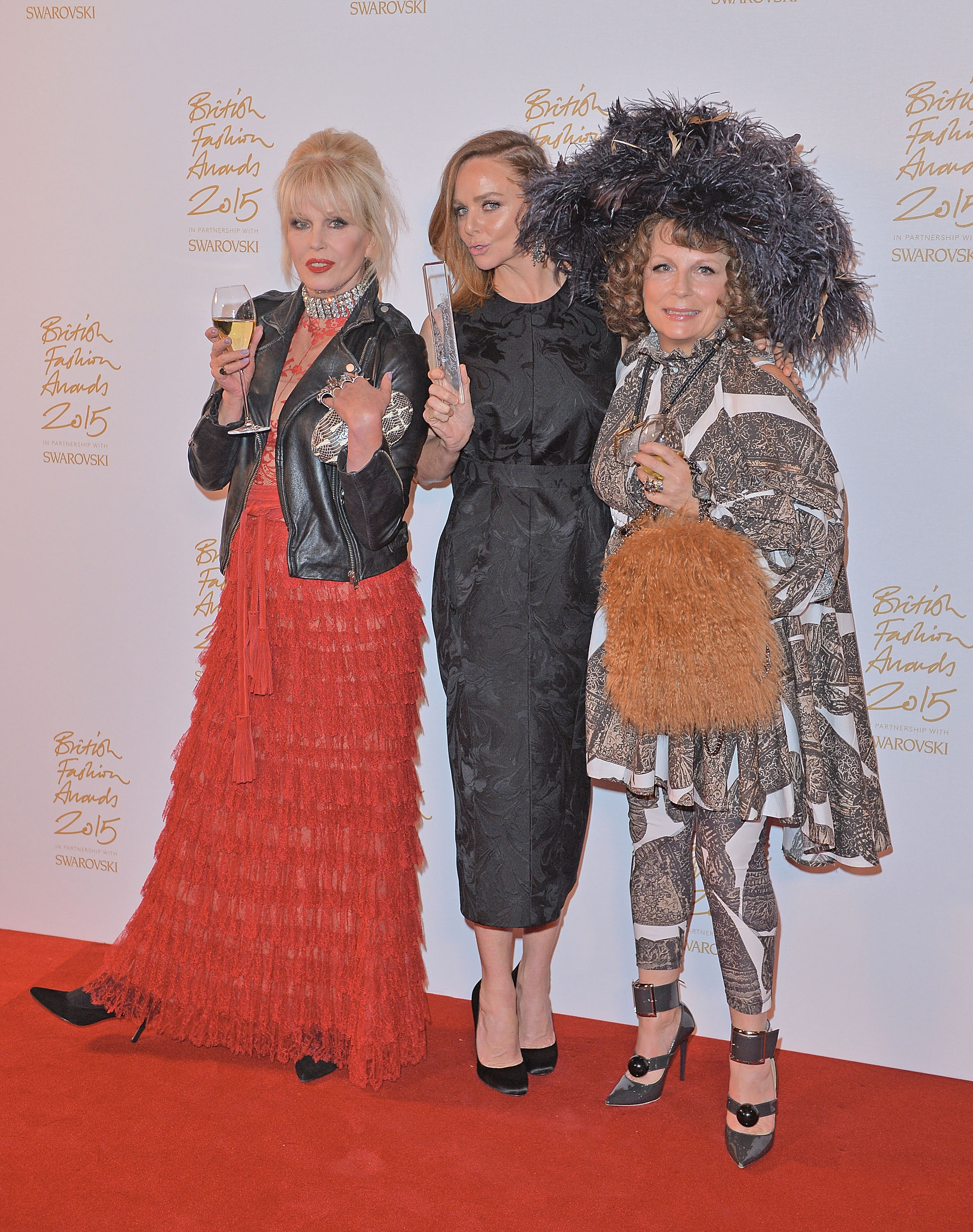 LONDON, ENGLAND - NOVEMBER 23: Joanna Lumley, Stella McCartney and Jennifer Saunders poses in the Winners Room at the British Fashion Awards 2015 at London Coliseum on November 23, 2015 in London, England. (Photo by Anthony Harvey/Getty Images)