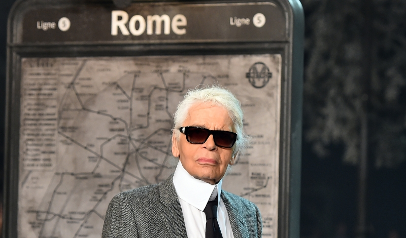 "German designer Karl Lagerfeld walks the runway at the end of the 12th Chanel Metiers dArt show ""Paris-Rome"", an annual event to honor craftsmanship that artisan partners bring to the houses collections, on December 1, 2015 at the Cinecitta studios in Rome.  AFP PHOTO / GABRIEL BOUYS / AFP / GABRIEL BOUYS        (Photo credit should read GABRIEL BOUYS/AFP/Getty Images)"