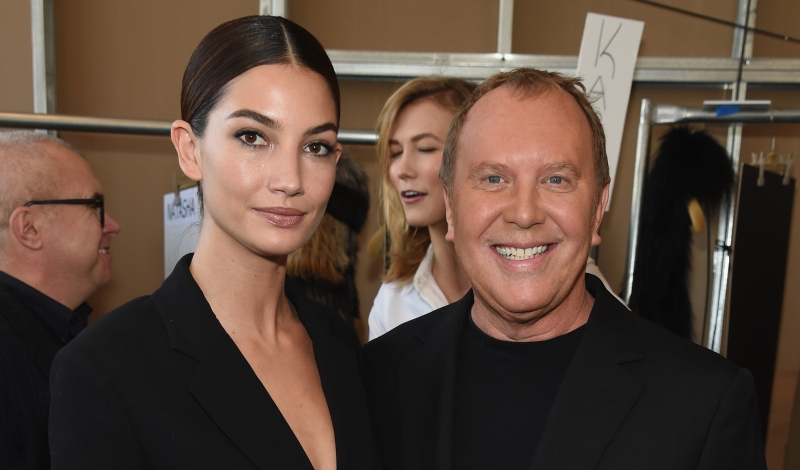 NEW YORK, NY - FEBRUARY 18: Lily Aldridge and designer Michael Kors pose backstage at the Michael Kors fashion show during Mercedes-Benz Fashion Week Fall 2015 at Spring Studios on February 18, 2015 in New York City. (Photo by Dimitrios Kambouris/Getty Images for Michael Kors)
