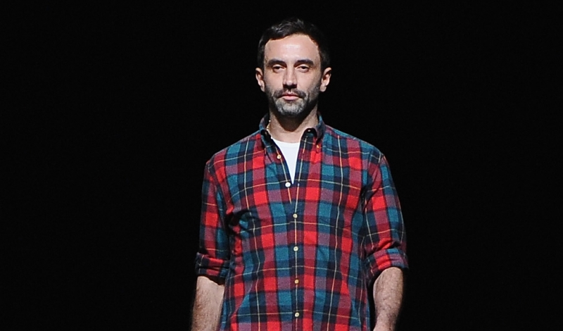 PARIS, FRANCE - MARCH 03:  Fashion designer Riccardo Tisci acknowledges applause foolowing the Givenchy  Fall/Winter 2013 Ready-to-Wear show as part of Paris Fashion Week on March 3, 2013 in Paris, France.  (Photo by Pascal Le Segretain/Getty Images)