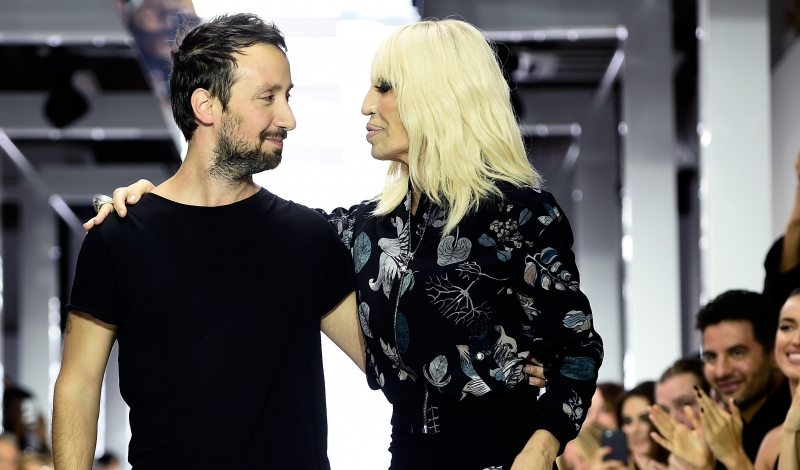 LONDON, ENGLAND - SEPTEMBER 19:  Creative director Anthony Vaccarello and Donatella Versace appear at on the runway at the Versus show during London Fashion Week Spring/Summer 2016 on September 19, 2015 in London, England.  (Photo by Ian Gavan/Getty Images)