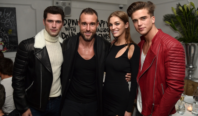 """NEW YORK, NEW YORK - APRIL 07:  (L-R) Sean O'Pry, Philipp Plein, Samantha Gradoville and River Viiperi attend the Philipp Plein dinner at Bagatelle on April 7, 2016 in New York City.  (Photo by Bryan Bedder/Getty Images for Philipp Plein )"""