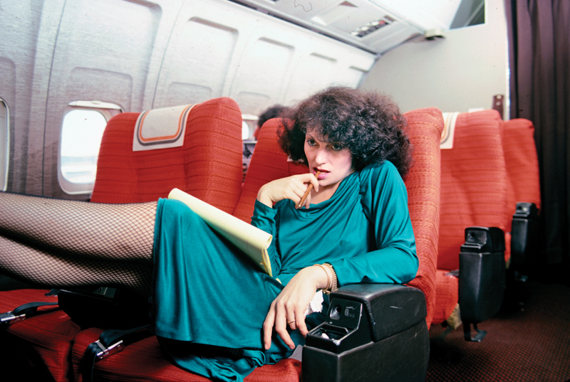 Portrait of Belgian-born fashion designer Diane von Furstenberg as she sits on an airplane at John F. Kennedy Airport, Queens, New York, May 1979. (Photo by Susan Wood/Getty Images)