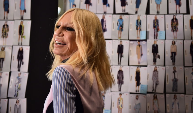 Designer Donatella Versace is pictured backstage before the show for fashion house Versace as part of the Women Autumn / Winter 2016 Milan Fashion Week on February 26, 2016.     AFP PHOTO / GABRIEL BOUYS / AFP / GABRIEL BOUYS        (Photo credit should read GABRIEL BOUYS/AFP/Getty Images)