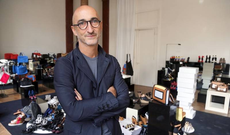 TO GO WITH AFP STORY BY DOMINIQUE AGEORGES - French jeweler and shoe designer, Pierre Hardy poses with some of his creations on September 20, 2012 in his office in Paris. Hardy is notably Hermes' Creative Director.  AFP PHOTO / PIERRE VERDY        (Photo credit should read PIERRE VERDY/AFP/GettyImages)