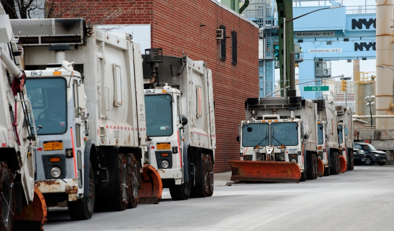 BROOKLYN, NY - JANUARY 22: New York City Department of Sanitation trucks, all with plows attached, sit on the street on January 22, 2016 in the Brooklyn borough of New York, NY. New Yorkers began preparing for the major snowstorm expected to arrive in New York City on Saturday morning.  (Photo by Bryan Thomas/Getty Images)