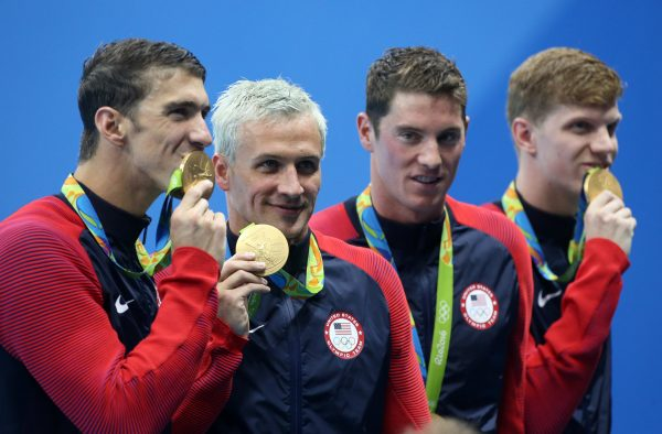 RIO DE JANEIRO, BRAZIL - AUGUST 9: Michael Phelps, Ryan Lochte, Conor Dwyer, Francis Haas of Team USA celebrate winning the gold medal during the medal ceremony of the men's 200m freestyle relay on day 4 of the Rio 2016 Olympic Games at Olympic Aquatics Stadium on August 9, 2016 in Rio de Janeiro, Brazil. (Photo by Jean Catuffe/Getty Images)