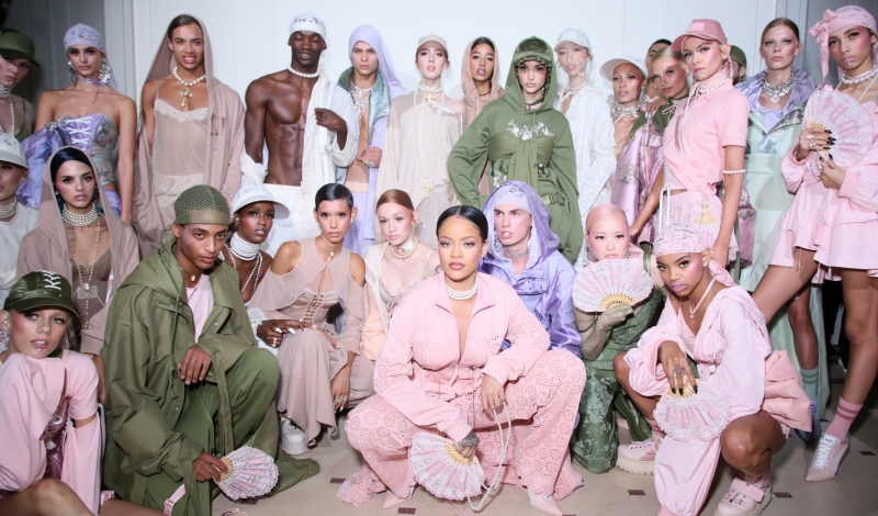 PARIS, FRANCE - SEPTEMBER 28:  Rihanna is seen with models backstage during FENTY x PUMA by Rihanna at Hotel Salomon de Rothschild on September 28, 2016 in Paris, France.  (Photo by Victor Boyko/Getty Images for Fenty x Puma)