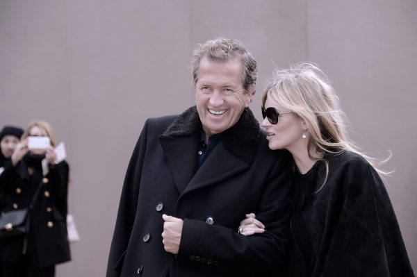 LONDON, ENGLAND - FEBRUARY 23: (Editors Note: Image has been digitally altered) Mario Testino and Kate Moss attend the Burberry Prorsum show during London Fashion Week Fall/Winter 2015/16 at Perk's Field on February 23, 2015 in London, England. (Photo by Gareth Cattermole/Getty Images)