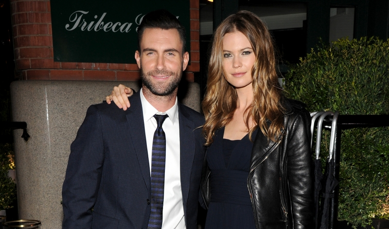 "NEW YORK, NY - APRIL 26:  Musician Adam Levine (L) and Behati Prinsloo attend the CHANEL Dinner in honor of the 2014 Tribeca Film Festival closing night film ""Begin Again"" at Tribeca Grill on April 26, 2014 in New York City.  (Photo by Bryan Bedder/Getty Images for CHANEL)"