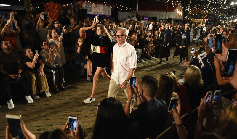 NEW YORK, NY - SEPTEMBER 09:  Model Gigi Hadid (L) and Designer Tommy Hilfiger walk the runway at the #TOMMYNOW Women's Fashion Show during New York Fashion Week at Pier 16 on September 9, 2016 in New York City.  (Photo by Grant Lamos IV/Getty Images for Tommy Hilfiger)