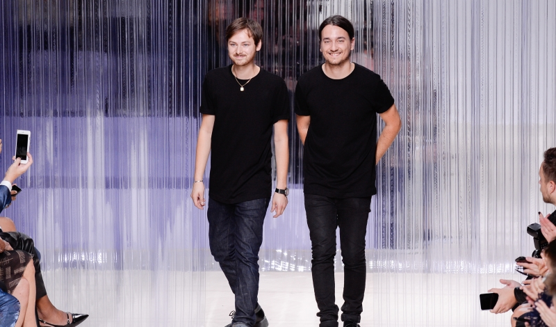 PARIS, FRANCE - OCTOBER 01:  French designers Alexis Martial (R) and Adrien Caillaudaud (L) acknowledge the public at the end of the the Carven show as part of the Paris Fashion Week Womenswear Spring/Summer 2016 on October 1, 2015 in Paris, France.  (Photo by Francois Durand/Getty Images)