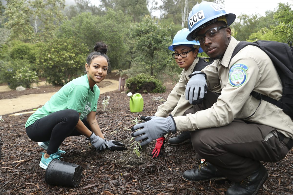 """BEVERLY HILLS, CA - JUNE 11: (L-R) Karrueche Tran with volunteers Leticia Cabrera and Davion Evans attend Sierra Club, National Parks Conservation Assoc & EMA """"Give Back Day"""" to celebrate the National Park Service Centennial at Franklin Canyon Park on June 11, 2016 in Beverly Hills, California. (Photo by Randy Shropshire/Getty Images for Sierra Club & National Parks Conservation Assoc.)"""