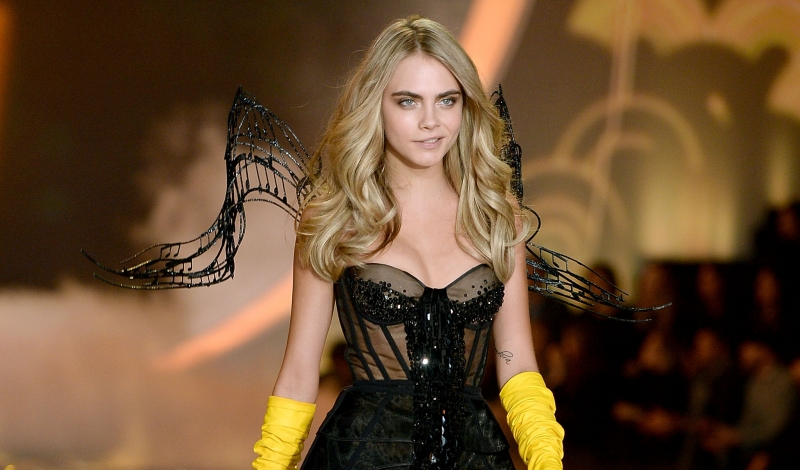 NEW YORK, NY - NOVEMBER 13:  Model Cara Delevingne walks the runway at the 2013 Victoria's Secret Fashion Show at Lexington Avenue Armory on November 13, 2013 in New York City.  (Photo by Dimitrios Kambouris/Getty Images for Victoria's Secret)