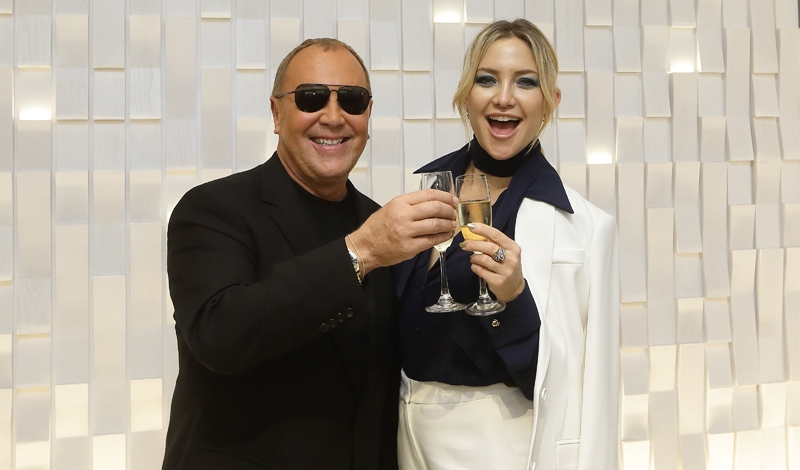 SINGAPORE - NOVEMBER 15:  (L-R) American designer, Michael Kors and American actress, Kate Hudson make a toast during the Michael Kors Mandarin Gallery Flagship Store Opening Cocktail Party at Orchard Road on November 15, 2016 in Singapore.  (Photo by Suhaimi Abdullah/Getty Images for Michael Kors)