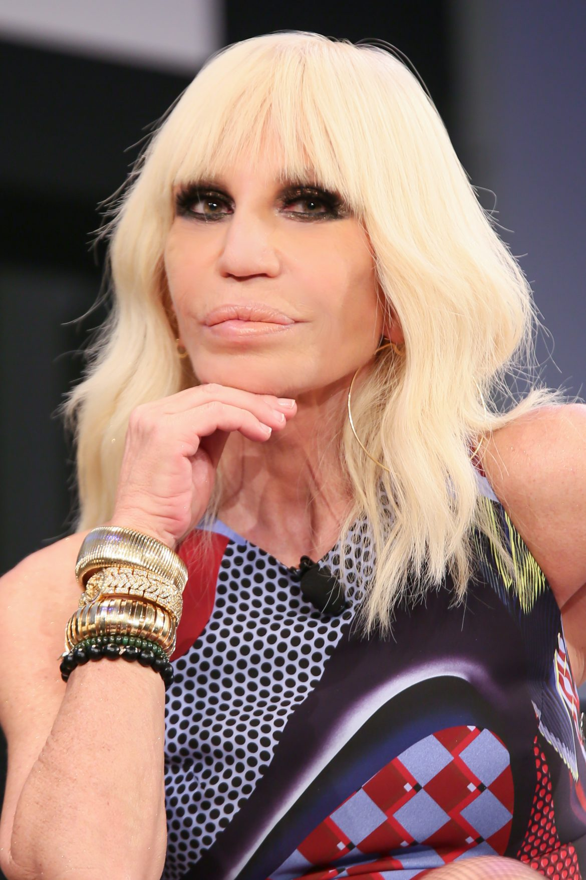 Donatella versace touts her new book daily front row for Donatella versace beach