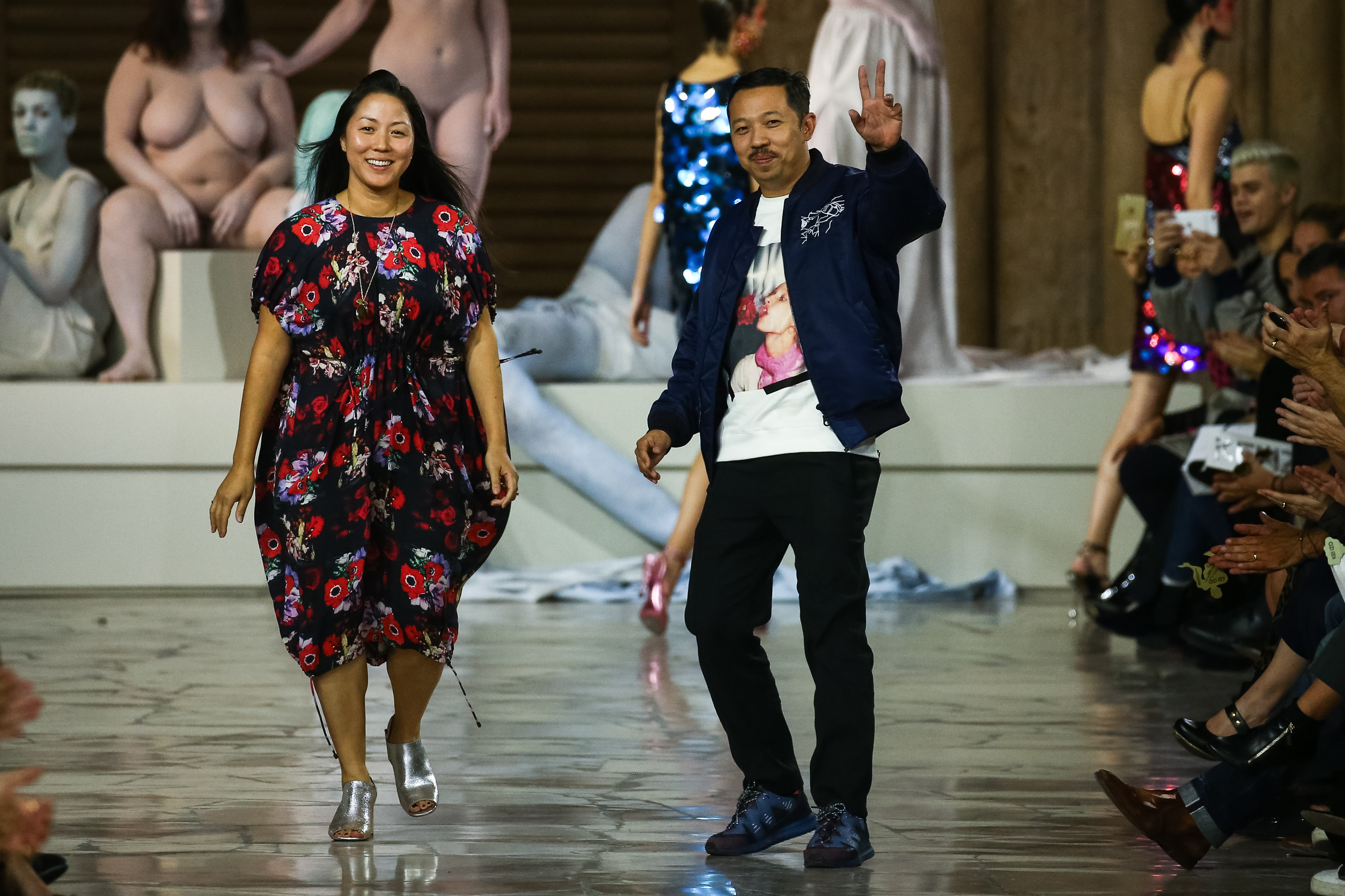 0d8e45a3 PARIS, FRANCE - OCTOBER 04: Designers Carol Lim and Humberto Leon walk the  runway during the Kenzo show as part of the Paris Fashion Week Womenswear  ...