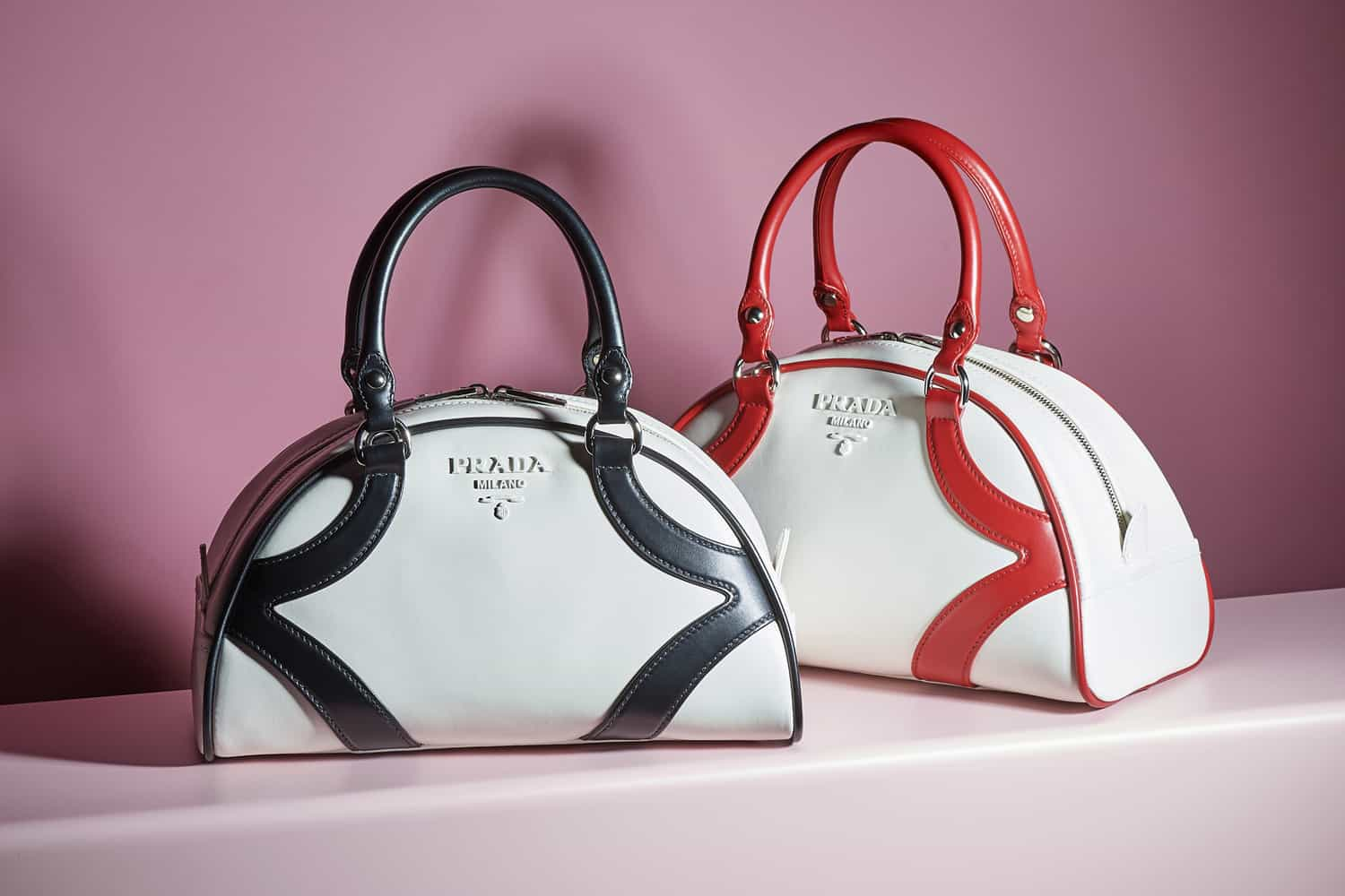 ccad6a350a52 For Resort 2020 Miuccia Prada took a trip down memory lane: she reissued  the Prada Bowling Bag in honor of its 20th anniversary! Eagle eye fans will  notice ...
